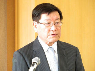 President Hisataka giving a speech